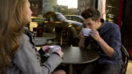 Girl and Guy flirt outside coffee shop video