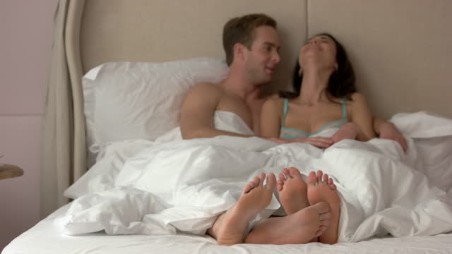 Girl and guy in bed. video