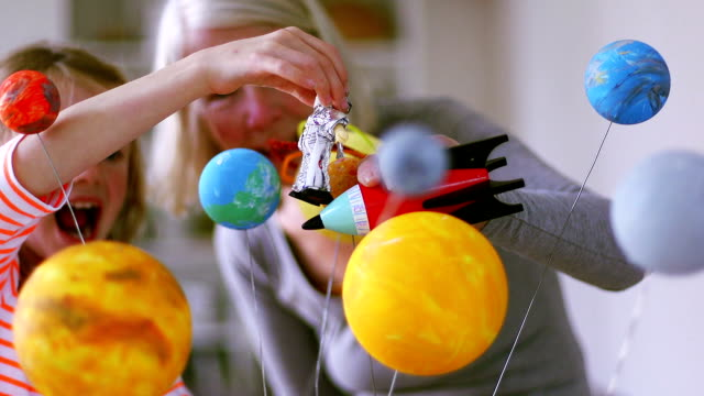 Girl and her grandmother exploring space video