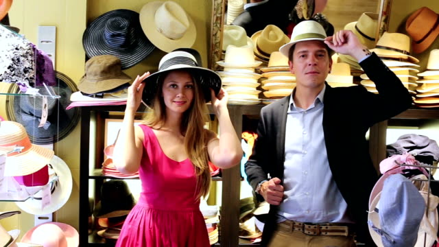 girl and male try on modern hats video