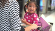 Girl and Mother Riding market cart In Shopping Mall video