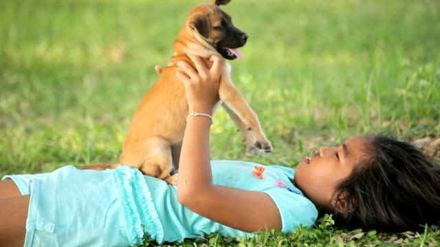 girl and puppy in the garden video