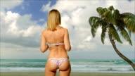 Girl blonde in swimsuit  posing near the sea video