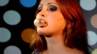 girl blowing a bubble with gum video