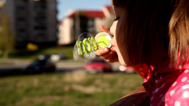 Girl blowing bubbles video