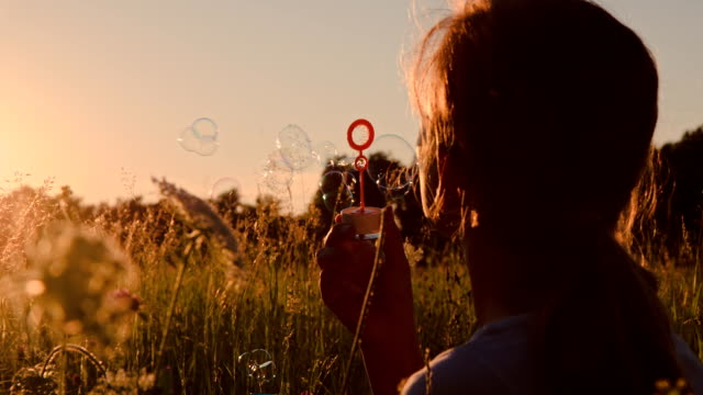 SLO MO Girl Blowing Bubbles video
