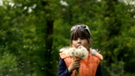 Girl Blowing Dandelion Seeds video