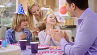 SLO MO girl blowing out candles for her tenth birthday video
