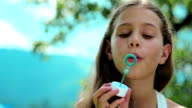 Girl blowing soap bubbles video