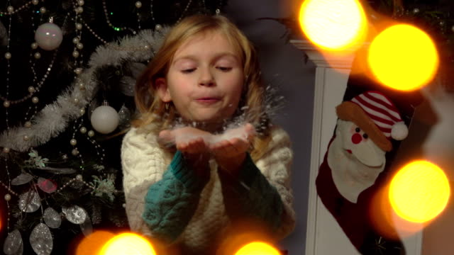 girl blows snow from the handprints video