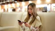 Girl buy online via smart phone video