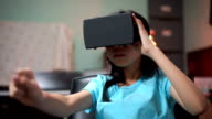 Girl catch something with Virtual Reality Headset video