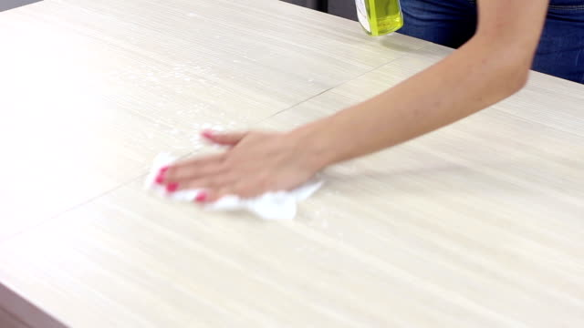 Girl cleaning and wiping table in kitchen video
