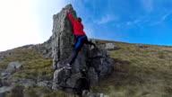 Girl climbing on the rock 4K video