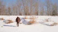 Girl climbing the winter hill video