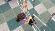 Girl climbs a ladder in the playground video