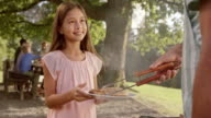 SLO MO Girl coming to grill with plate video