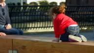 Girl crawls on bench video