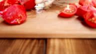 girl cuts tomatoes closeup video