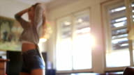 Girl dancing in the house bathed in sunshine! video