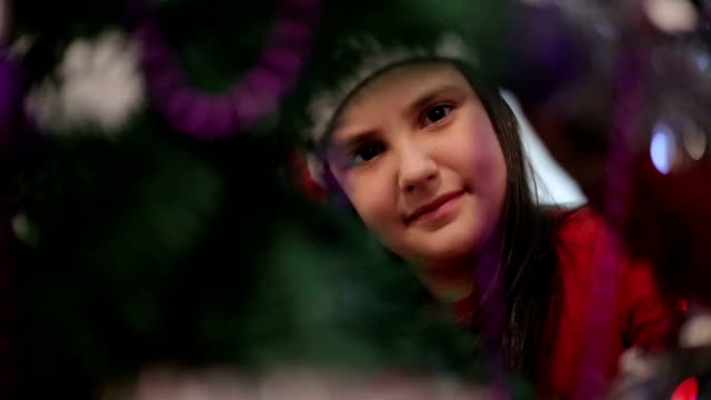 girl decorates a Christmas tree video