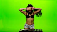 Girl DJ makes erotic movements with his hands. Green screen. Slow motion video