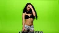 Girl dj sexy dance and controls the decks. Green screen video