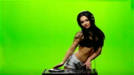 Girl DJ spins the spinner and moves in different directions. Slow motion video