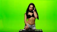 Girl DJ turntables and dancing twist. Green screen. Slow motion video