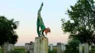 Girl does handstand and twine exercise video