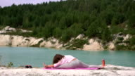 Girl does yoga video
