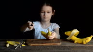 Girl doing a toy from bananas video