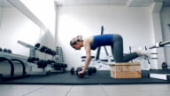 girl doing Exercise for Gym Fitness Workout with Exerciser Wheel  Roller video