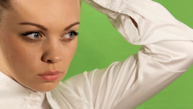 Girl doing hairstyle in the beginning of the working day. video