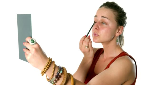 Girl doing her make up applying mascara or brushing her eyelids video