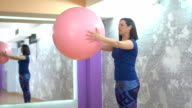 Girl doing pilates in gym video
