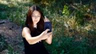 girl doing selfie on her smartphone outdoor video