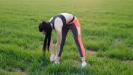 Girl doing standing forward bend outdoors video