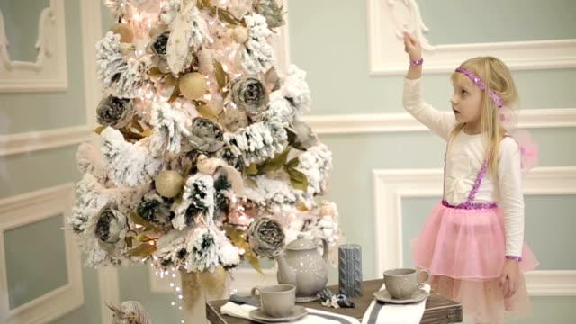 Girl dressed as fairy waving a magic wand. video