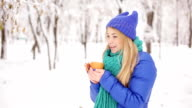 Girl drink coffee outdoors winter. video