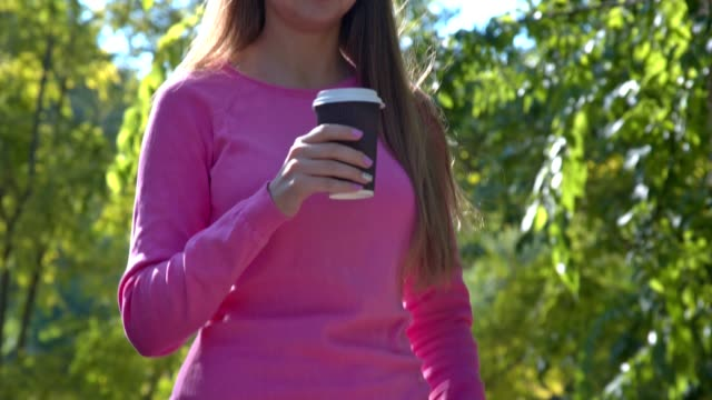 Girl Drinking Coffee Outdoors video