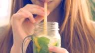 Girl drinking lemonade. video