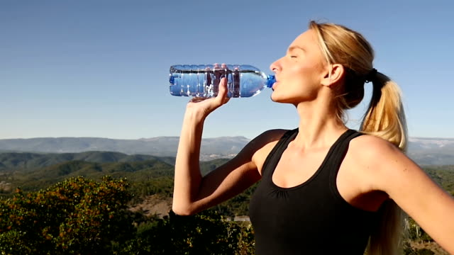 Girl drinking water after sport activity video