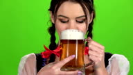 Girl drinks beer and sexy licked. Green screen. Slow motion video