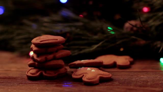 Girl eating a gingerbread man cookies video