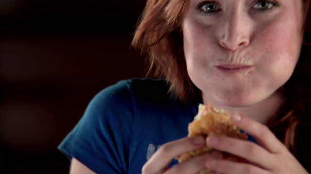 Girl eating a sandwich video