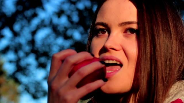 Girl eating an apple video