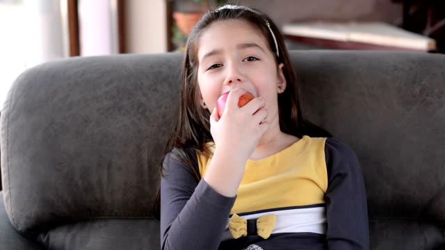 Girl eating apple. video