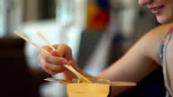 Girl eating Chinese noodles video