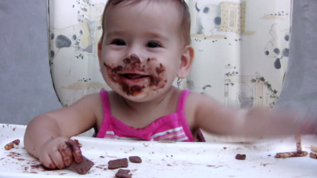 Girl eating chocolate (HD) video